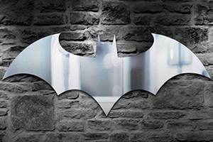 Stunning Batman bat logo shaped glass mirror.
