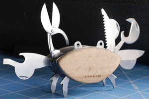 Pocket-sized multi-tool gadget in shape of a crab, complete with eyes and tool pincers.