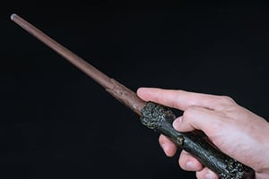 Programmable remote control shaped like a magic wand from Harry Potter.