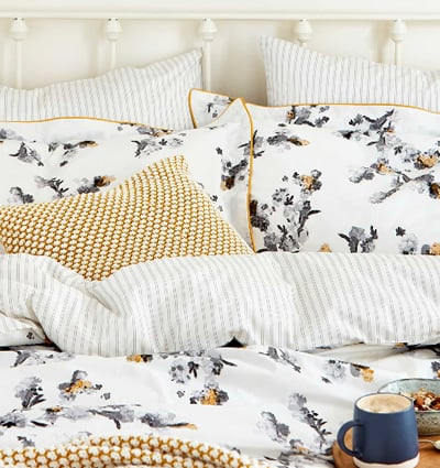 Joules 'Mono Blossom' Bedding - Crisp white bedding with a monochrome blossom design with highlights and trimming in a fresh yellow.