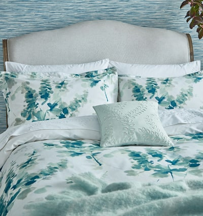 Sanderson 'Delphiniums' Bedding: Mint-green watercolour painted abstract floral pattern on a fresh, white background.