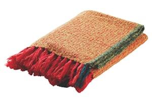 Howen orange wool throw with dark green edging and red tassels.