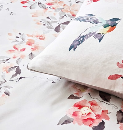 Sanderson 'Magnolia & Blossom' Bedding: A delicate hand-drawn pattern featuring Magnolia flowers and Cherry blossom, alongside the occasional bird and bee.
