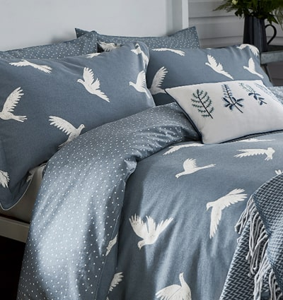 Sanderson 'Paper Doves' Bedding: A fun denim coloured design decorated with large white flying doves.