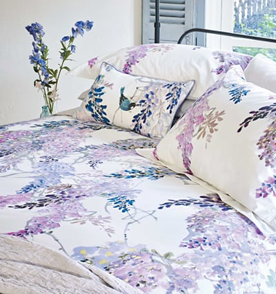 Sanderson 'Wisteria Falls' Bedding: A super summery, bold, lilac Wisteria blossom design featuring birds and butterflies.